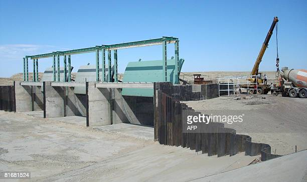Construction workers build the Aklak dike as part of the Kokaral dam project on Kazakhstan's Aral Sea on June 19 2008 The Aklak dike is being built...