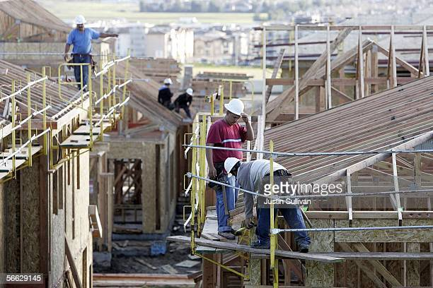Construction workers build the framing on a new home under construction January 19 2006 in Dublin California The Commerce Department reported that...