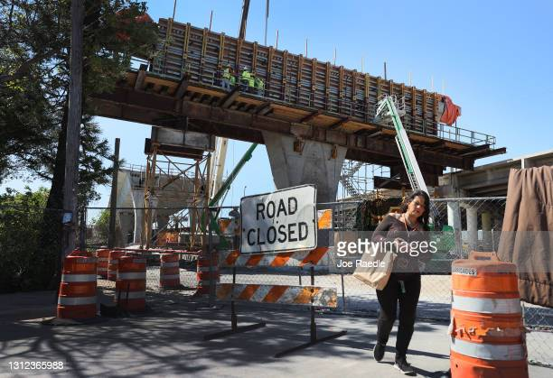 """Construction workers build the """"Signature Bridge,"""" replacing and improving a busy highway intersection at I-95 and I-395 on April 13, 2021 in Miami,..."""