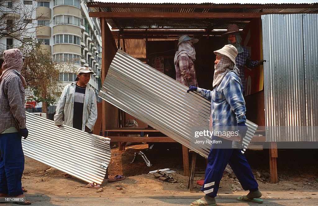 Construction workers build themselves temporary houses from scrap materials found at a construction site in Chiang Mai..