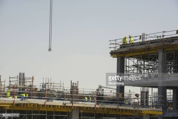 Construction workers build venues for the World Expo 2020 exhibition in Dubai United Arab Emirates on Tuesday Jan 23 2018 Much of the Arab world is...