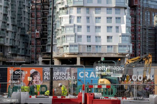 Construction workers carry on the development at Nine Elms, Battersea, during the second lockdown of the UK's Coronavirus pandemic, when all but...