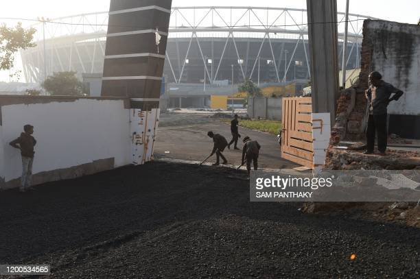 Construction workers carry on works on an entrance to the Sardar Patel Stadium World's in Motera on the outskirts of Ahmedabad on February 13 2020...