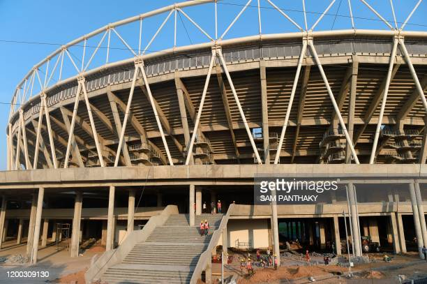 Construction workers carry on works outside the Motera stadium the world's largest cricket stadium on the outskirts of Ahmedabad on February 12 2020