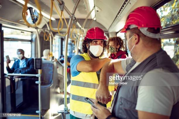 construction workers commuting on a bus - belgrade serbia stock pictures, royalty-free photos & images