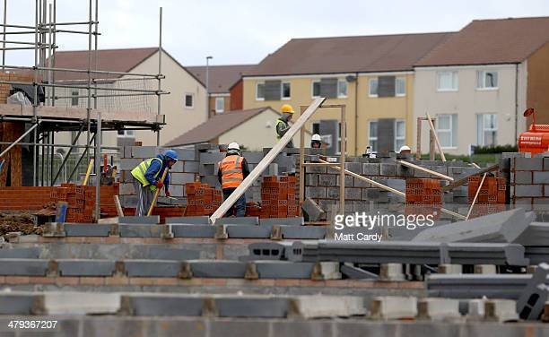 Construction workers continue to build new houses on a housing development on March 18 2014 in Bristol England A number of housebuilders are now...