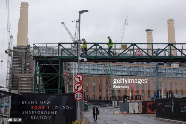 Construction workers cross a bridge at the Battersea Power Station development in London, U.K., on Tuesday, June 30, 2020. U.K. Prime Minister Boris...