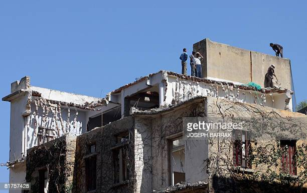 Construction workers demolish an old house in Ashrafieh in the eastern outskirts of Beirut on June 19 2008 The Ottomanstyle mansions with Venetian...
