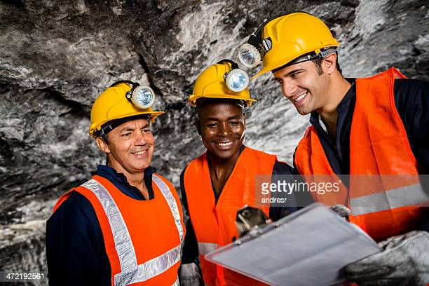 construction workers digging a tunnel - underground mining stock photos and pictures