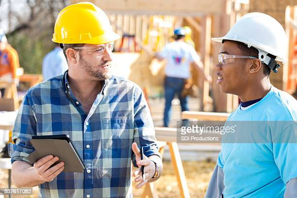 Construction workers discuss new home