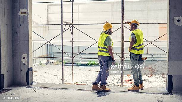 Construction workers discussing
