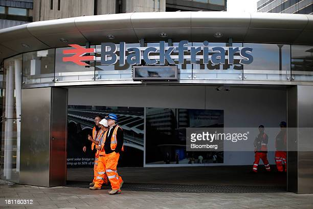 Construction workers exit Blackfriars Bridge railway station development in London UK on Wednesday Sept 18 2013 UK commercial real estate values rose...