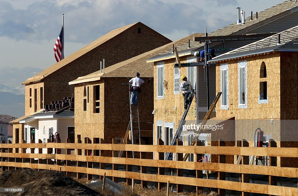 Construction workers finish homes at The Overlook by Oakwood Homes on 48th Ave. near Picadilly Rd. Tuesday 1/13/03. The residential development is part of ...