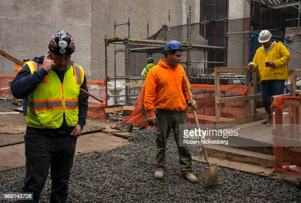 Construction workers finish the exterior of a New YorkPresbyterian Hospital building in New York City October 12 2017 Major private donations to the...