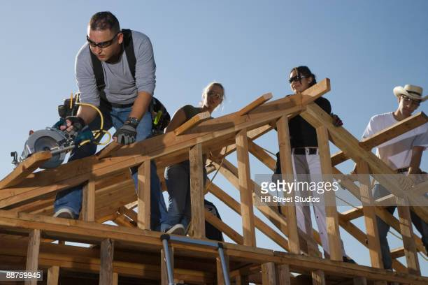 Construction workers framing house