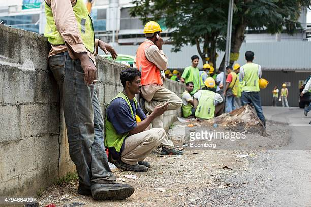 Construction workers from Pakistan take a break in Kuala Lumpur, Malaysia, on Tuesday, March 18, 2014. Malaysia, aspiring to become a developed...
