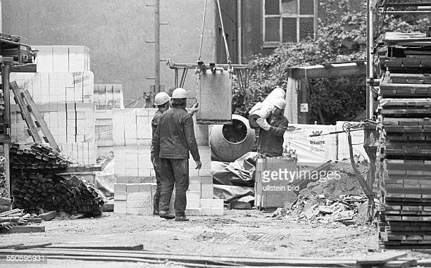 Construction workers from the GDR working in West Berlin workers from the Maschinen und Baukombinat Bernburg at a construction site at...