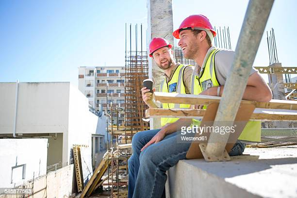 Construction workers having a break in construction site