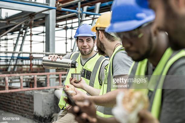 Construction workers having a break on construction site