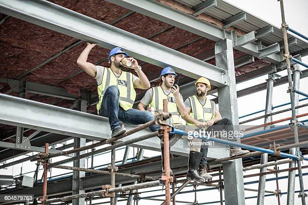 Construction workers having a break on scaffolding