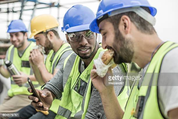 Construction workers having lunch break on construction site