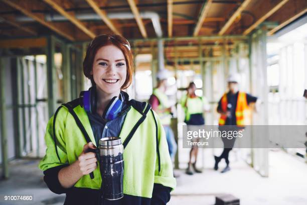 Construction workers in Australian in building site working and doing tasks.