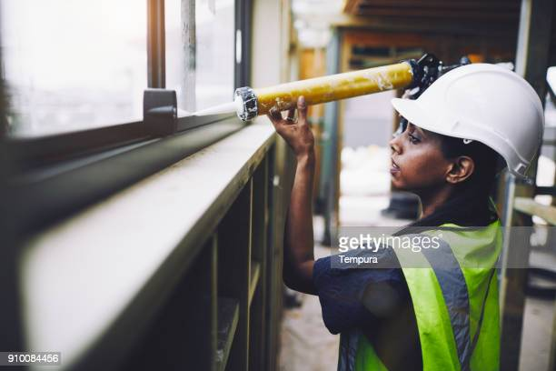 construction workers in australian in building site working and doing tasks. - building contractor stock pictures, royalty-free photos & images