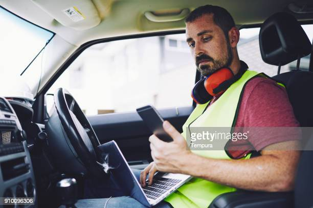 construction workers in australian in building site working and doing tasks. - foreman stock pictures, royalty-free photos & images