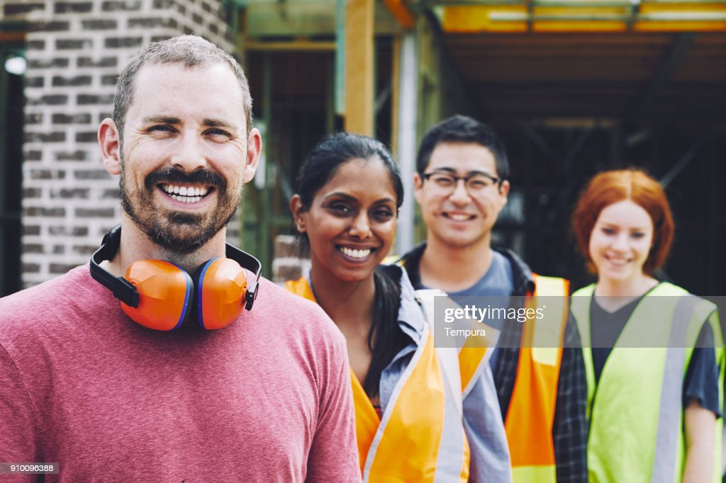Construction workers in Australian in building site working and doing tasks. : Stock Photo