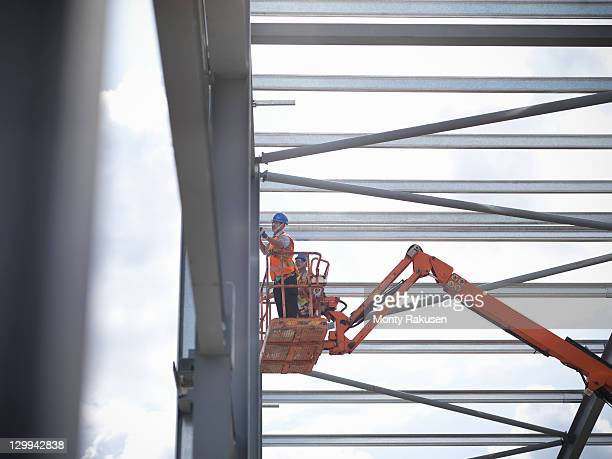 Construction workers in cherry picker