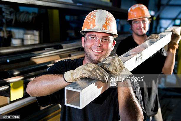 construction workers in hard hats working - work glove stock photos and pictures