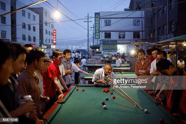 Construction workers in Lanzhou playing pool.