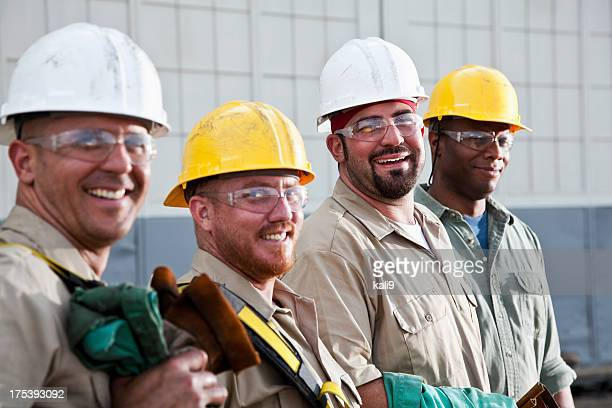 construction workers in safety gear - stereotypically working class stock pictures, royalty-free photos & images