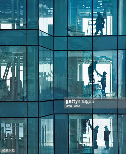 Construction Workers Inside High-rise Building