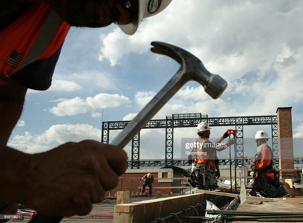 Construction workers install rebar for beam pockets on the f : News Photo