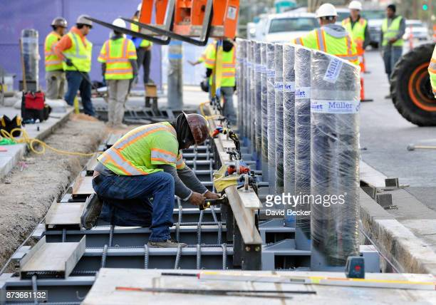 Construction workers install the first of 800 bollards near the Hawaiian Marketplace on the Las Vegas Strip to help protect pedestrians from vehicles...