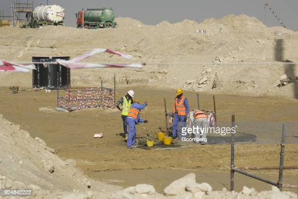 Construction workers labor at the building site for the World Expo 2020 exhibition in Dubai United Arab Emirates on Tuesday Jan 23 2018 Much of the...