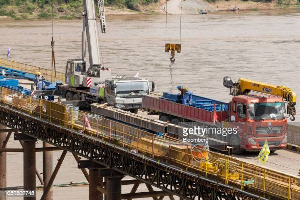 Construction workers labor on the Luang Prabang railway bridge a section of the ChinaLaos Railway built by the China Railway Group Ltd stand under...