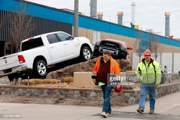 Construction workers leave FCA Chrysler Warren Truck Assembly after the Detroit three automakers have agreed to UAW demands to shut down all North...