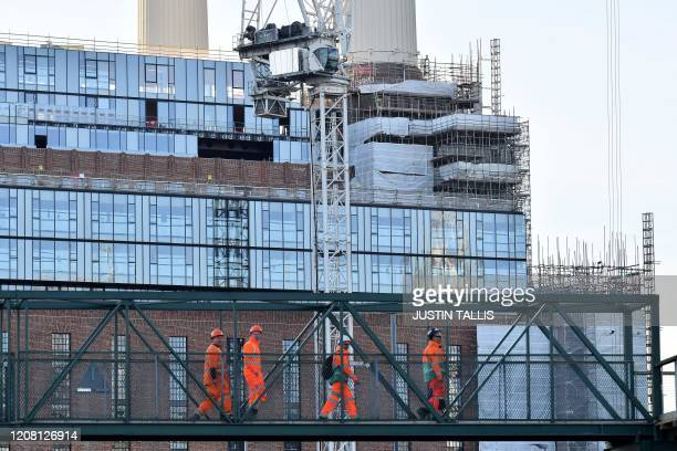 Construction workers leave the Battersea Power Station development in south London on March 24 as Britain's Chancellor of the Duchy of Lancaster...