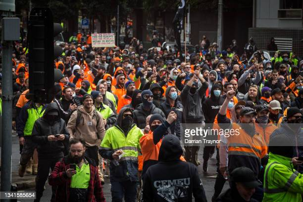 Construction workers march through the streets on September 21, 2021 in Melbourne, Australia. Protests started outside the headquarters of the...