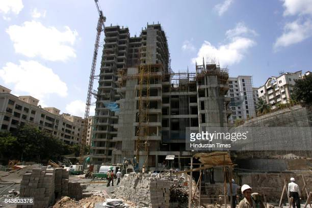 Construction workers move ashfly blocks to be used to builld Raheja Vista in Powai one of Mumbai's green homes Such ecofriendly material make...