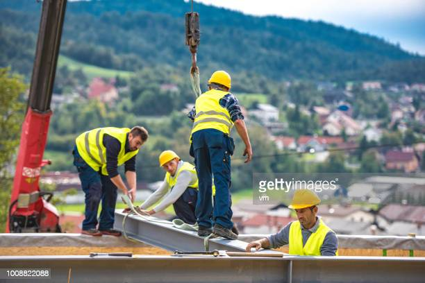 construction workers on a girder - danger stock pictures, royalty-free photos & images