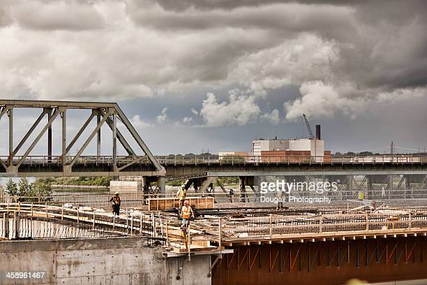 construction workers on cirlce drive south bridge in saskatoon - south saskatchewan river stock photos and pictures