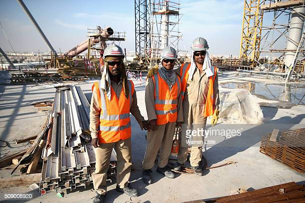 Construction workers on Khalifa International Stadium ahead of the 2022 FIFA World Cup Qatar on December 30 2015 in Doha Qatar