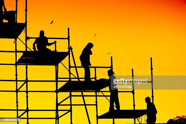 Construction Workers on Scaffolding - Silhouette