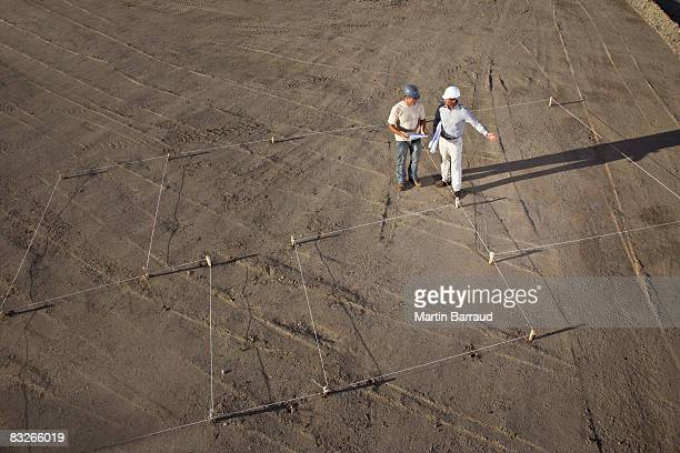 Construction workers outlining construction site