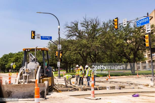 Construction workers perform road work during a heatwave in Dallas, Texas, U.S., on Thursday, June 17, 2021. Texas is pushing homes and businesses to...