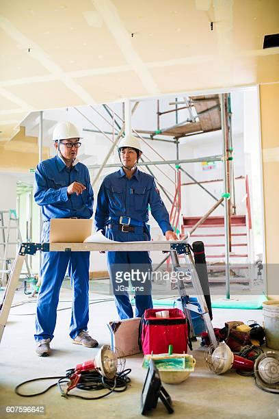 Construction workers performing a site inspection