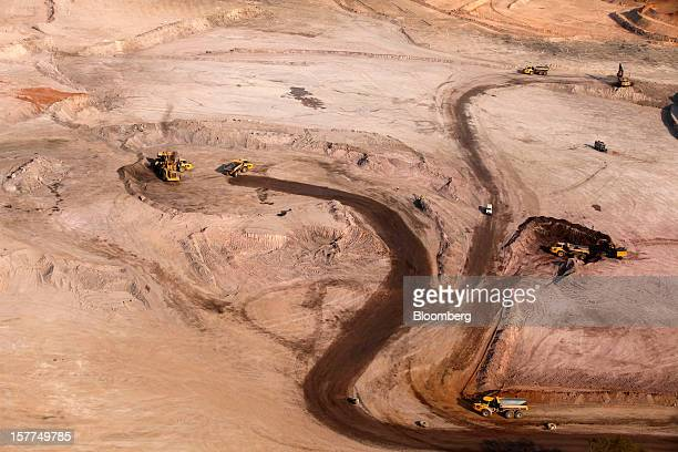 Construction workers prepare new roads near one of the open pits at Comide SPRL's Mashitu copper mine operated by Eurasian Natural Resources Corp in...